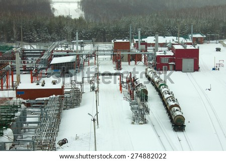 Winter industrial landscape oil refinery in the forest - stock photo