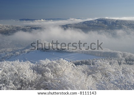 Winter inversion in hilly country (north Bohemia). - stock photo