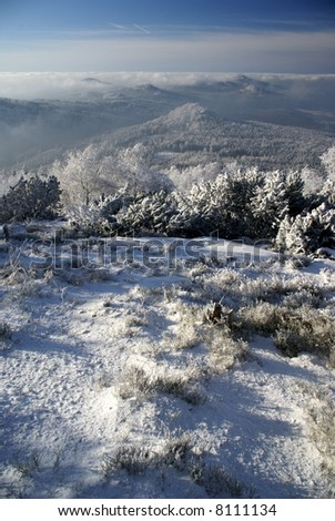 Winter inversion - lookout from mountain on valley with low clouds (north Bohemia). - stock photo