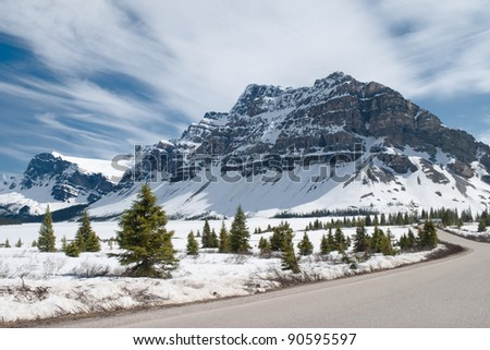 Winter landscape. Canadian Rocky Mountains, fir trees, and frozen Bow Lake covered by snow. Banff National Park, Alberta, Canada. - stock photo
