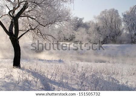 winter landscape frosty day on the river Zai - stock photo