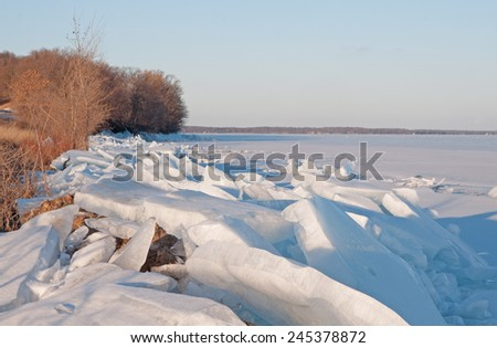 Winter landscape: Ice chunks along lake shore of Mille Lacs Lake in Minnesota - stock photo