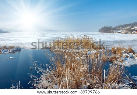 Winter landscape is with a lake