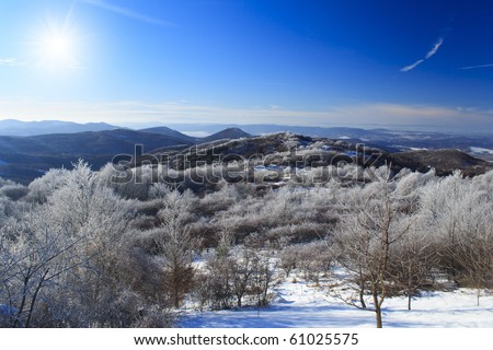 Winter landscape, mountens with frozen trees and blue sky in Hungary - stock photo