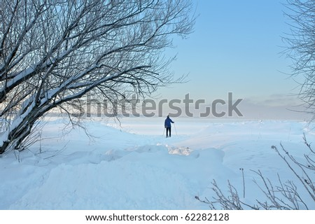 Winter landscape of beautiful nature and  skier on blue sky background - stock photo