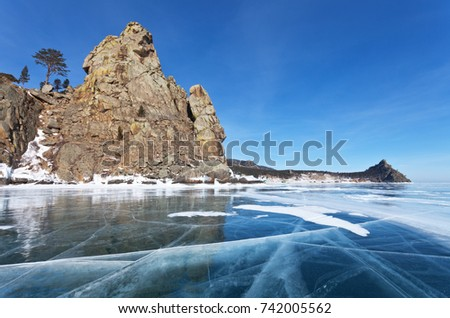 Winter landscape of the frozen Lake Baikal. The natural landmark of the lake is Sandy Bay (Peschanaya), framed by beautiful rocks called the Big and Small Belltowers