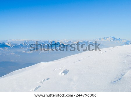 Winter landscape, snow on high mountains with blue sky background