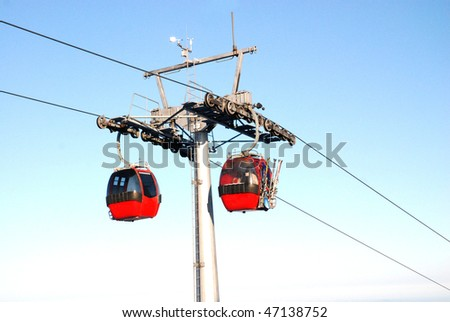 Winter landscape with a red cable car - stock photo