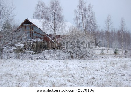 winter landscape with an old deserted hut in central Finland - stock photo