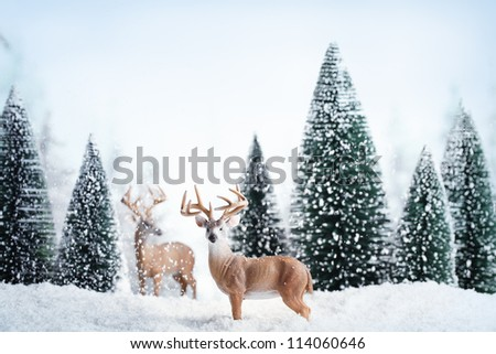 Winter landscape with deers,snow and fir tree. - stock photo