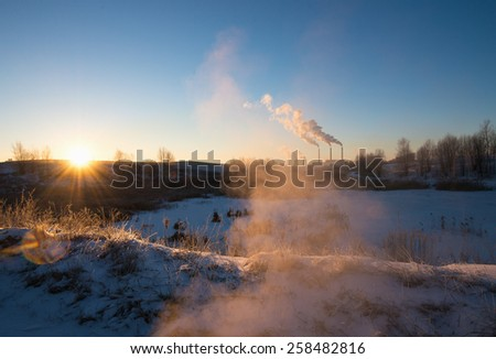 Winter landscape with factory chimneys  - stock photo