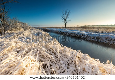 winter landscape with frosted river and white snow - stock photo