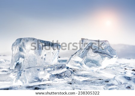 Winter landscape with ice on the lake at sunset. Small depth of sharpness.  - stock photo