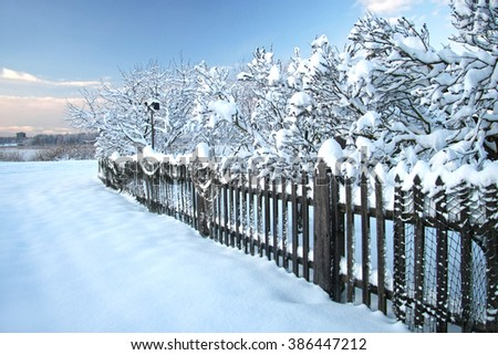 Winter landscape with snow covered trees.Old farm  at winter - stock photo