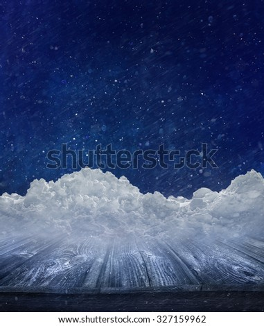 Winter landscape with snow covered wooden table - stock photo