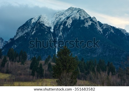 Winter landscape with spectacular rocky mountains powdered with snow