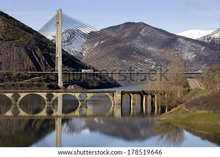 Winter landscape with  two bridges, the new and the old one, over a reservoir.  Two bridges over a reservoir.  - stock photo