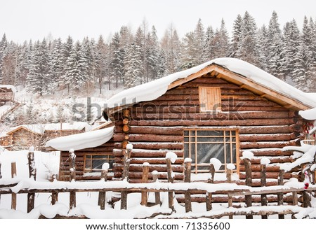 Winter log cabin - stock photo