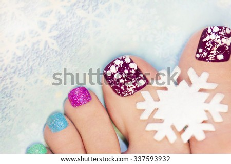 Winter manicure with snowflakes and sequins of different colors. - stock photo