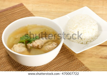 Winter Melon Soup with Chicken on Mat with Cooked Rice.