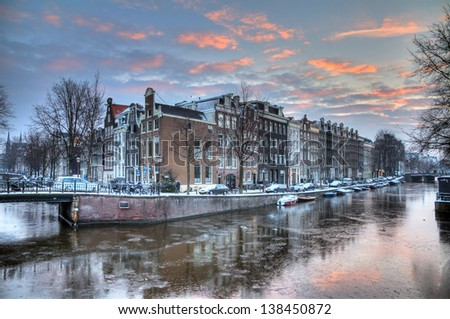 Winter morning canal in Amsterdam, the Netherlands, a UNESCO world heritage site. HDR - stock photo