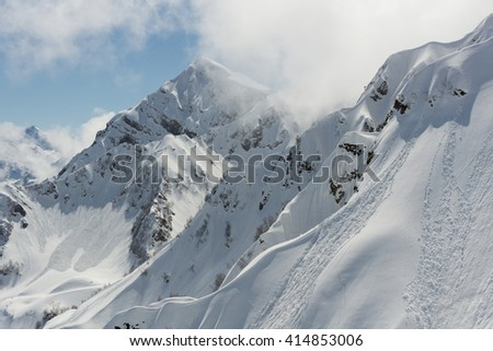 Winter mountain landscape and cloudy sky. - stock photo
