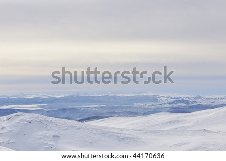 winter mountain landscape at sunny day and snow peaks - stock photo