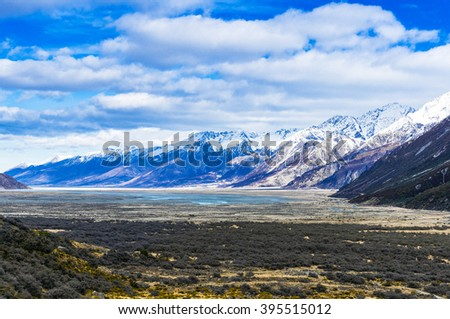 Winter mountain landscape. Tasman valley in winter with snow covered mountains and blue sky. Beautiful winter mountain landscape. - stock photo