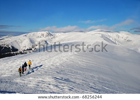 Winter mountain landscape with tourists