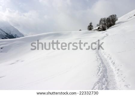 Winter mountain path in Swiss Alps - stock photo