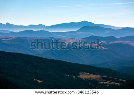 Winter Mountain View with many layers prospective and foggy remote ridges