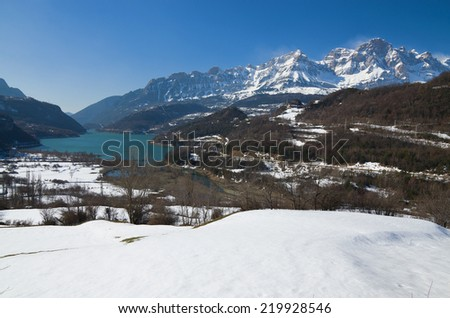 Winter mountains are photographed in the neighborhood of Panticosa. There is an artificial lake (Embalse de Bubal) in the Valle de Tena in Huesca, Aragon in Spain. - stock photo