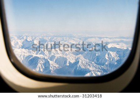 Winter mountains from the plane window - stock photo