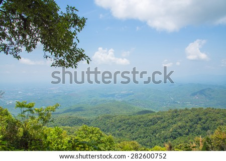winter mountains green grass and blue sky landscape