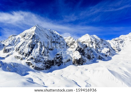 Winter mountains, panorama - snow-capped peaks of the Italian Alps - stock photo