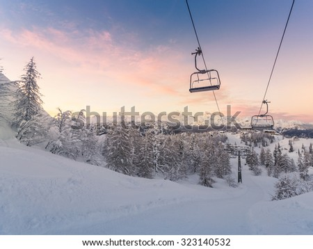 Winter mountains panorama with ski slopes and ski lifts near Vogel ski center, Slovenia - stock photo