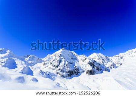 Winter mountains - ski slopes in Italian Alps - stock photo