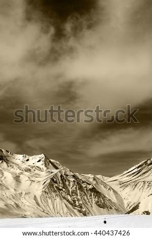 Winter mountains with clouds. Caucasus Mountains, Georgia,region Gudauri. Sepia toned. - stock photo