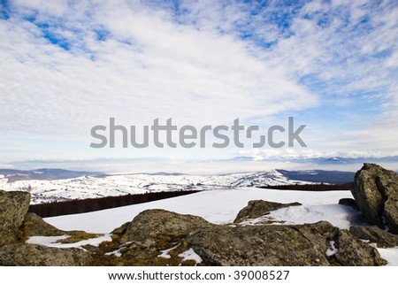 winter mountains with snow and clouds in day light