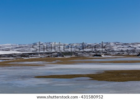 Winter natural landscape with mountain background and clear blue sky, Iceland - stock photo