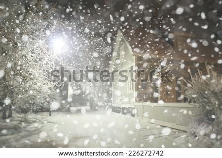 Winter night  street in city, snowfall. - stock photo