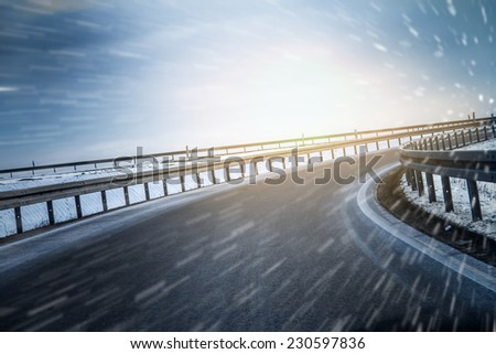winter on highway curve - stock photo