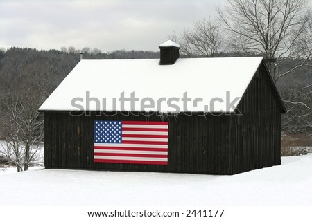 Winter on the farm and an American flag. - stock photo