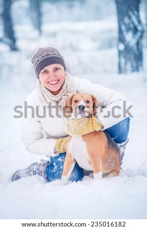 Winter outdoor portrait happy woman with her pet - stock photo