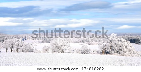 Winter panorama hills of  Gory Stolowe ( Table Mountains ) in Poland - stock photo
