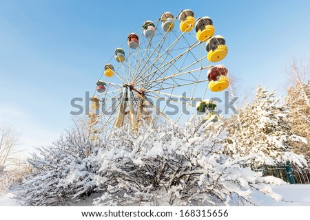 Winter panorama of abandoned Ferris wheel, Pervouralsk, Urals, Russia - stock photo