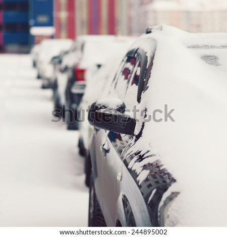 Winter parking, cars in the snow - stock photo
