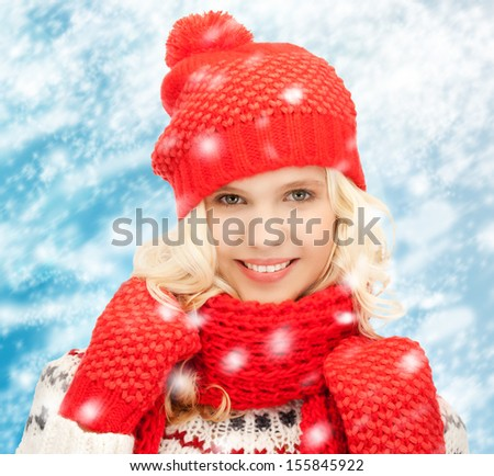 winter, people, happiness concept - teenage girl in hat, muffler and mittens - stock photo