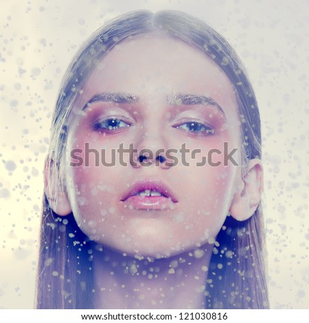 winter portrait fashion face freeze wind blue gamma ice looking portrait snow flakes background - stock photo