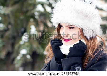 Winter portrait of a beautiful girl outdoors. - stock photo